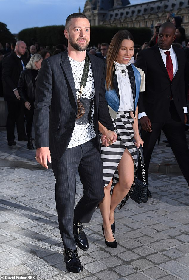 Shrugging it off: Justin flashed a warm smile as Jessica put on a leggy display at his side