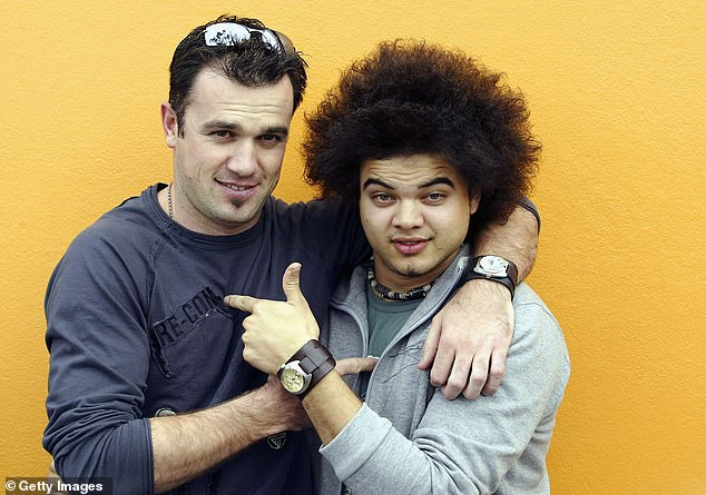 'I was so embarrassed, I felt like the whole room was looking at me and everything was swallowing me up. I already had people down on me because of Idol,' Guy said of the sledging. He's pictured here with Shannon Noll in 2003