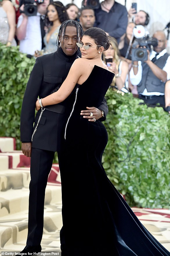 Smitten: It's believed Kylie fell pregnant in May, a month after they began dating, and later in the month the couple were spotted together at the Met Gala