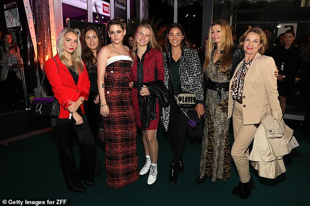 Posing up a storm: Kristen posed with attendees at the premiere
