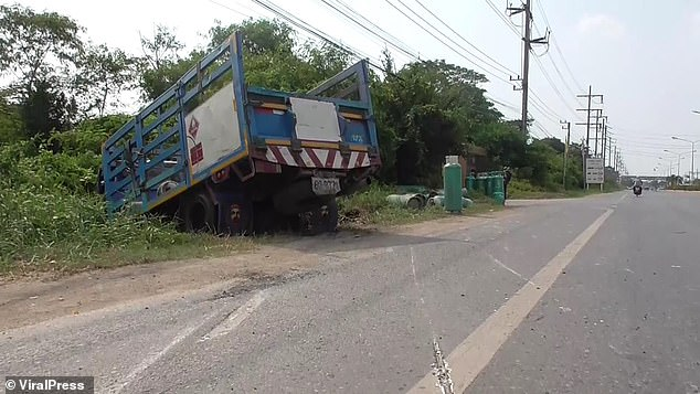 After losing the tyre, the truck driver lost control and crashed into a nearby ditch to the side of the road