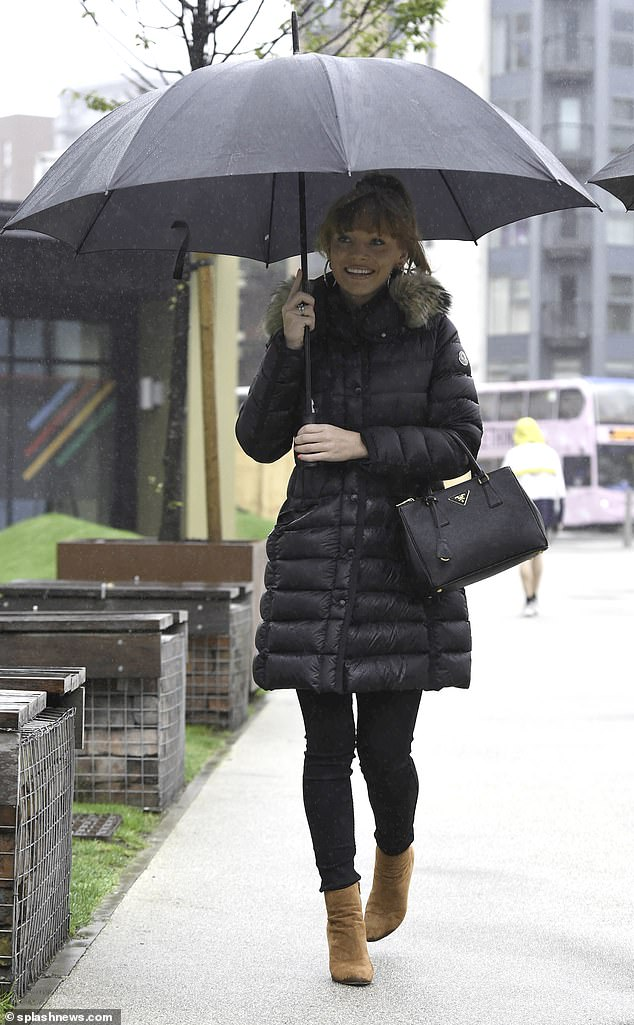 Ready for winter! Summer Monteys-Fullam, 24, she battled wet and windy weather upon leaving her hotel in Manchester on Friday morning