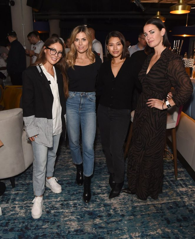 Looking good: The Made In Chelsea alum added a stylish twist with a unique loose fit jacket boasting a pin-striped lower half and coordinating cuffs as she posed with (L-R)Zoe Hardman, Vanessa and Kirsty