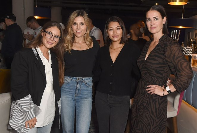 Autumnal attire: The ladies displayed their transitional style sense at the event