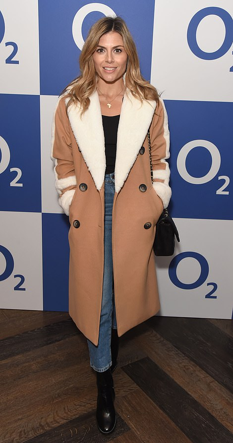 Autumn chic: The mother-of-one wrapped up in a tan coloured coat