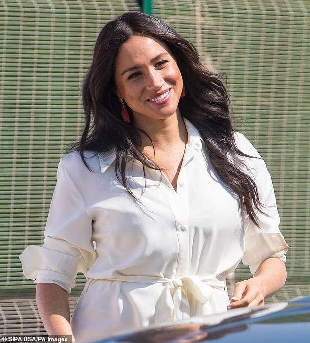 Duchess of Sussex' friends spoke of her being 'guided by a deep sense of gratitude and humility' and being someone who 'personifies elegance, grace, philanthropy'. Pictured in Johannesburg on October 2