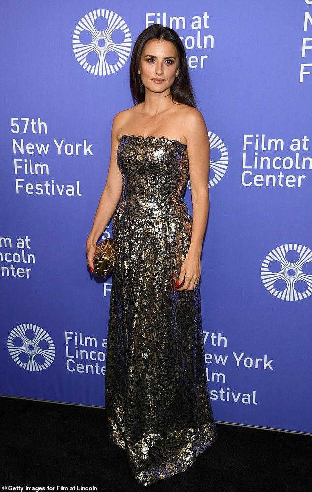 Golden girl: The Oscar winning actress carried a small golden clutch, accessorizing with gold hoop earrings