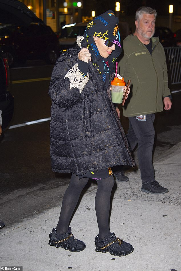Incognito: Madonna, 61, cut a casual figure as she arrived at the Howard Gilman Opera House in New York City on Saturday
