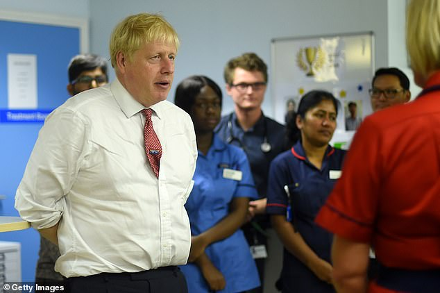 Remainers have lost a court bid to threaten Boris Johnson (pictured visiting a hospital in Watford today) with jail if he flouts a rebel law ordering him to seek a Brexit extension