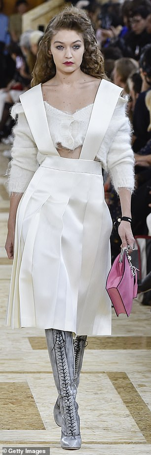 Flirty frock: She flashed her tone tummy in this two piece by Miu Miu, also on Tuesday