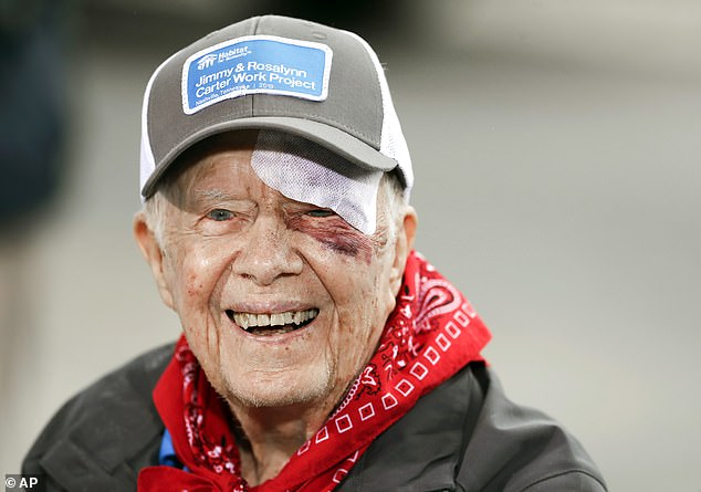 The bandage covering Carter's 14 stitches and his black eye peeked out from under his cap