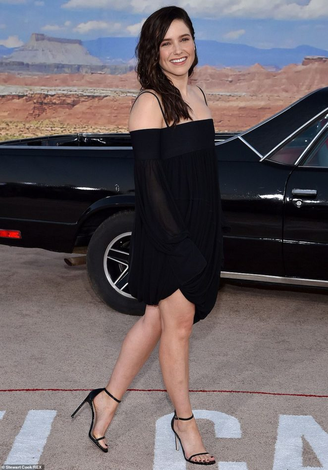 Off-the-shoulder: Sophia Bush sported a strappy black off-the shoulder dress with matching strappy six-inch stilettos