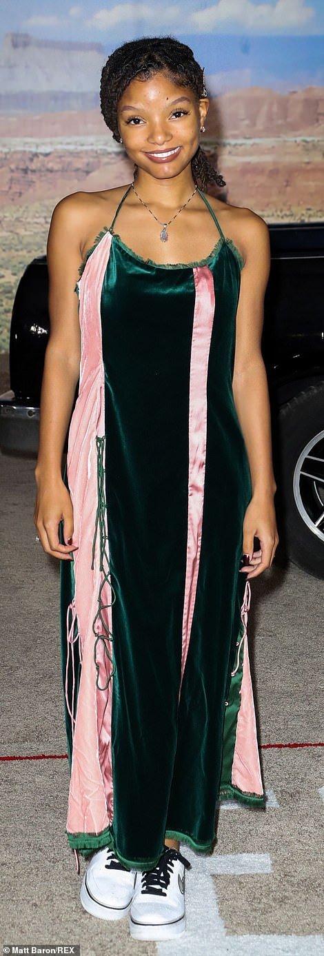 Emerald and blush: Halle Bailey donned a horizontal-striped emerald green and blush pink velvet dress with a spaghetti-strap halterneck