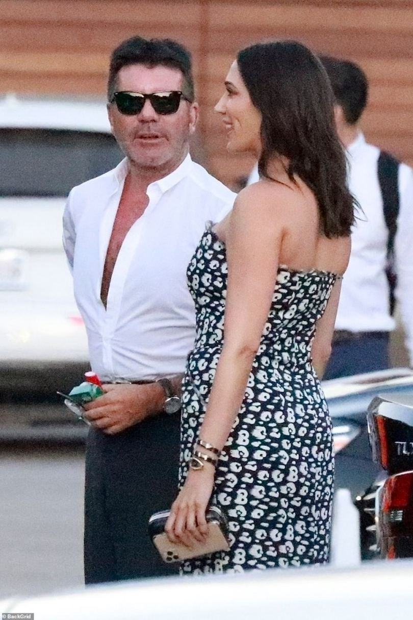 Stunning: Lauren meanwhile pulled out all the stops in a tight-fitting black and white print strapless dress for her beau's celebrations