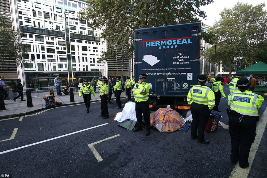 A lorry blocks Marsham Street, outside the entrance to the Home Office, another Government department targeted today
