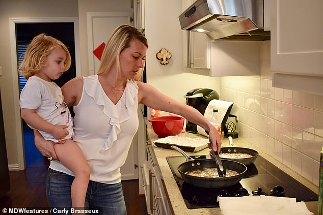 Carly, pictured with her three-year-old daughter, cooks up her kills and home and hasn't needed to buy meat for years