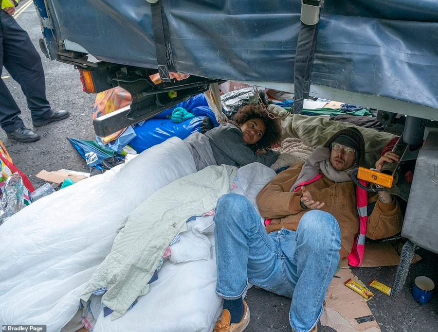 Activists were tucked in under duvets and blankets and bound to the lorry with bike locks to make it harder for police to arrest them
