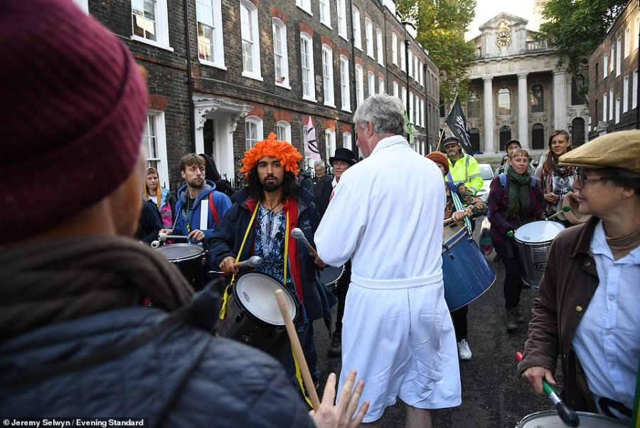 What a racket! Lord Fraser's white dressing gown stands out among the XR crowds