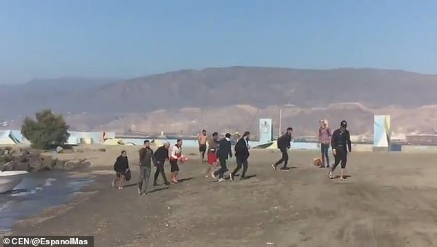They then immediately sprint across the sand while reports say onlookers called the police