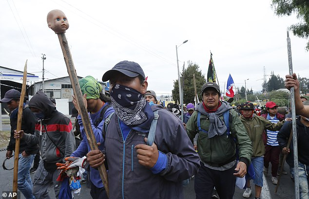 Otavalo indigenous anti-government demonstrators arrive to join other indigenous groups to protest against President Lenin Moreno's economic policies on October 8, 2019
