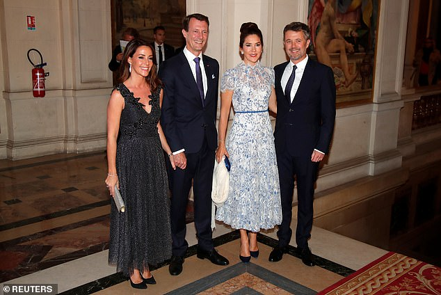 Princess Mary, 47, second right, and husband Crown Prince Frederik, 51, far right who are on the second day of their three-day official visit to France, were joined by his brother Prince Joachim, 50, second left, and his wife Princess Marie, 43, left