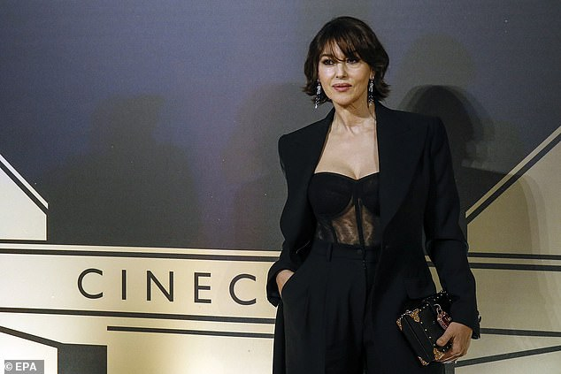Style: The actress set pulses racing in a sexy black bodice which flashed her toned abs thanks to its semi-sheer detailing