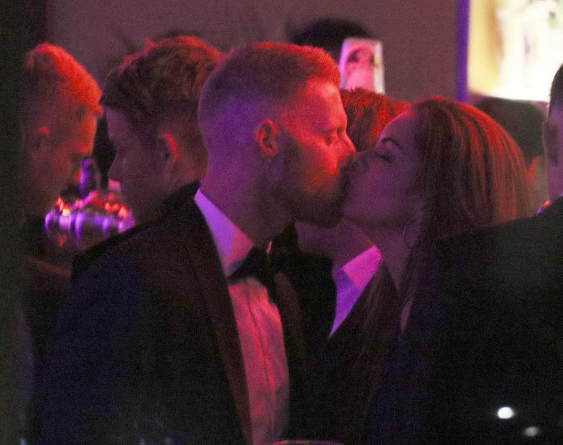 In separate pictures, the couple were pictured kissing at the bar of the Camden venue, and seem to be having a good time