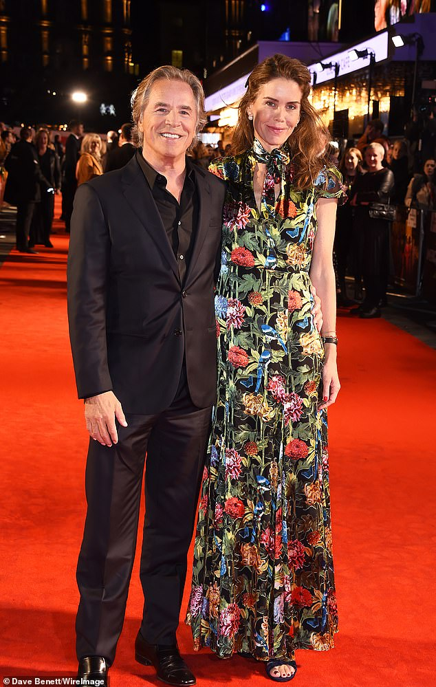Couple: Don Johnson, 69, and his wifeKelley Phleger, 50, stunned on the red carpet for his upcoming film Knives Out in London on Tuesday night