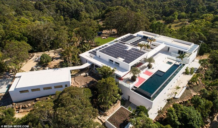 A modern palace!Extraordinary aerial photos taken on Monday show how the 4.2 hectare property has been completely transformed since Chris and Elsa purchased it five years ago