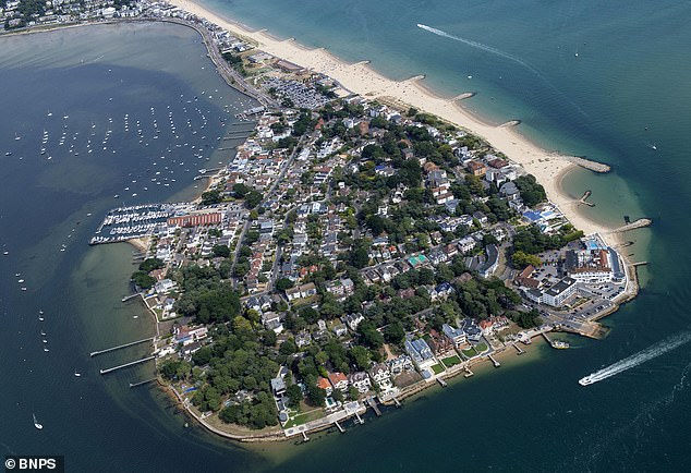 Georgewas arrested at his family's home 140 yards from the yacht club on Sandbanks (above)
