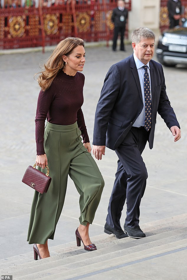 Kate Middleton, 37, looked typically demure in a pair of khaki-coloured culottes from Jigsaw, which she paired with a burgundy long-sleeved top