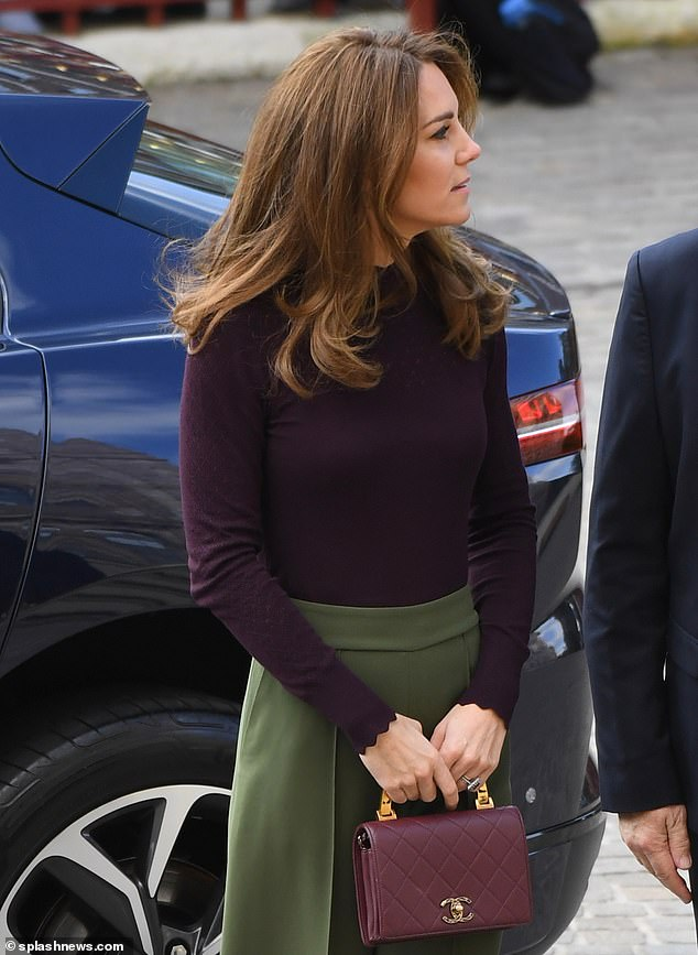The Duchess coordinated her £3k Chanel bag with matching burgundy heels and a high neck long-sleeved top, which featured scallop detail around the sleeves and neck