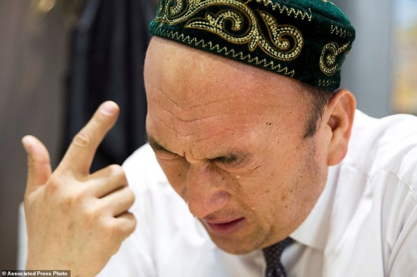 Omir Bekali, who claims to have been detained in one of the Muslim re-education camps, cries as he details the psychological stress endured in the internment camp. The programme aims to rewire detainees' thinking and reshape their identities