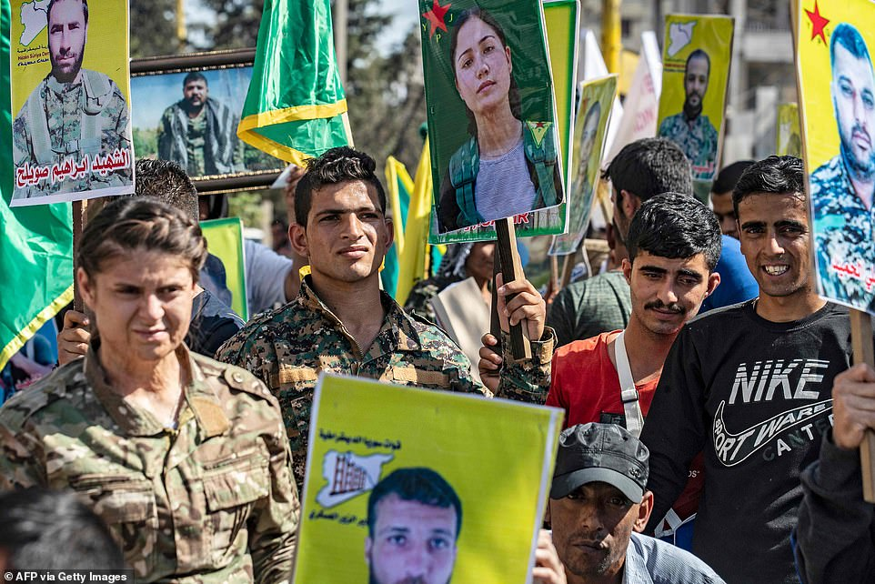 The Syrian government - which the US has attempted to topple - has called on the Kurds (pictured) to switch allegiance to their side if America withdraws its support