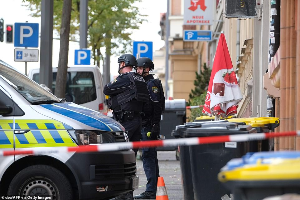 Police block the area around the site of a shooting in Halle an der Saale, eastern Germany