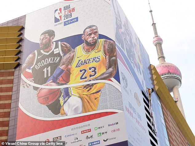 Workers in multiple spots around Shanghai removed large roadside NBA promotional signs that were advertising a preseason game between the Lakers and Nets scheduled for Thursday