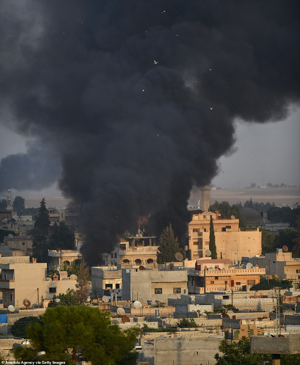 Smoke rises at the site of Ras al-Ayn city of Syria as Turkish troops along with the Syrian National Army begin Operation Peace Spring in northern Syria