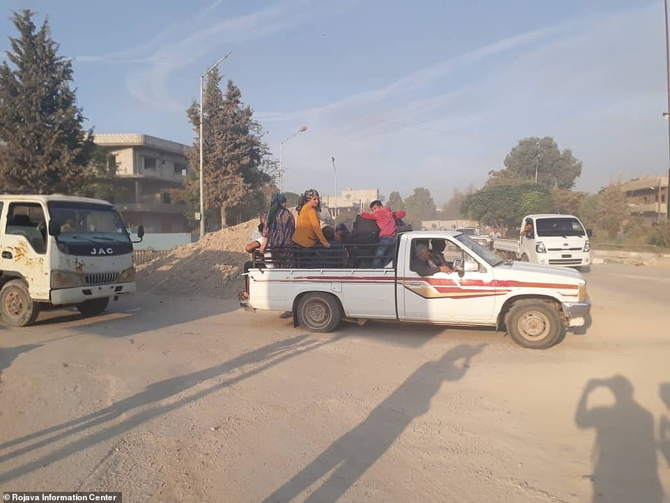 Civilians leaving in trucks as Turkish planes bombarded Syrian border towns today. President Erdogan announced the launch of Operation Peace Spring as his troops moved into the area
