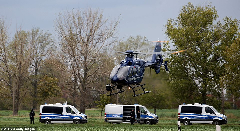 A helicopter takes off as police secure the area between Wiedersdorf and Landsberg near Halle, eastern Germany