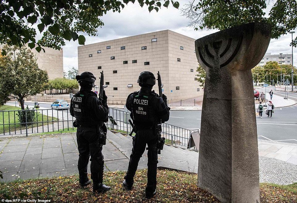 Police armed with sub-machine guns and wearing armour and helmets secure the area around a memorial commemorating the 1938 Crystal Night pogroms, close to the synagogue in Dresdenas a precautionary measure