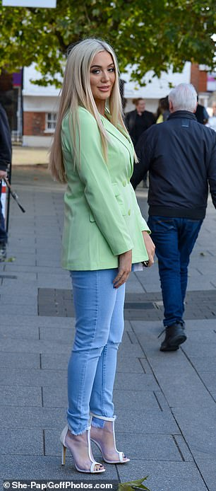 Sky-high: She teamed the look with white heels