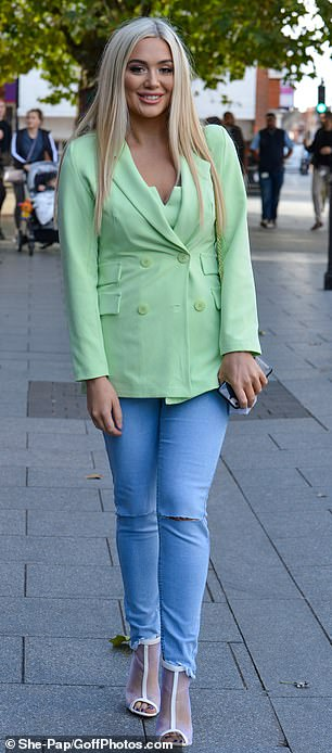 Green with envy: Joining the girls was Frankie Sims, 24, who cut a stylish figure in a green blazer and ripped denim jeans