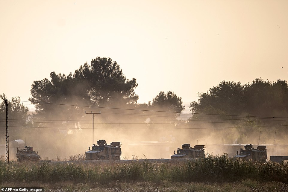 Turkish army vehicles drive towards the Syrian border near Akcakale in Sanliurfa province today as Ankara launched an assault on Kurdish forces in the region