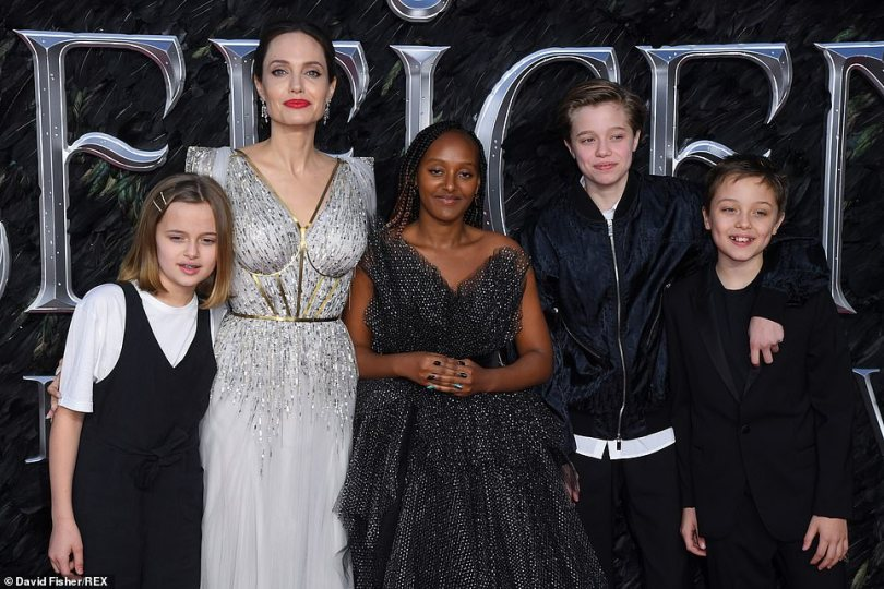 Posing on the red carpet with her children Zahara, 14, Shiloh, 13, and 11-year-old twins Vivienne and Knox, the Oscar-winning actress absolutely stunned in a sparkling metallic silver dress with gold panelling