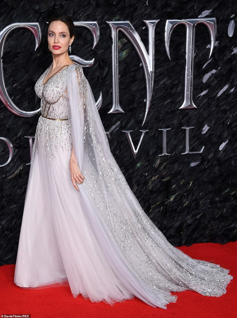 Perfection: The glittering train of Angelina's stunning gown swept the red carpet