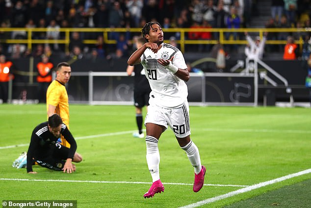 Serge Gnabry celebrates scoring Germany's first goal of the night against Argentina