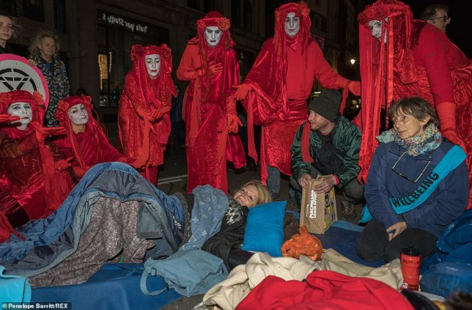 The Red Brigade group has hit the streets of London in the Extinction Rebellion protestsat Trafalgar Square last night