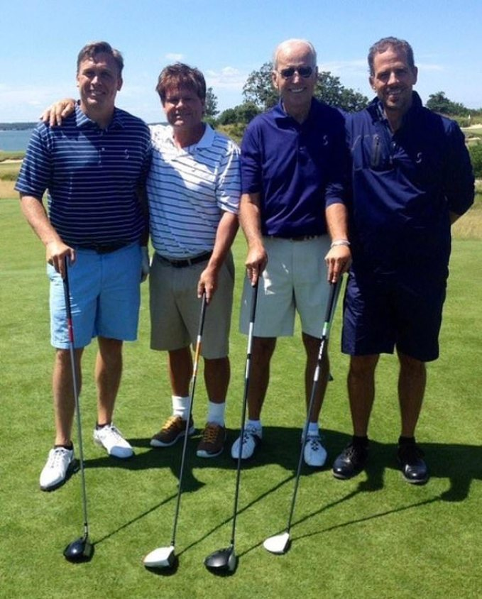 Devon Archer, far left, golfing in the Hamptons with former Vice President Joe Biden and his son Hunter, far right, in 2014. Archer served on the board of the Ukrainian natural gas company Burisma Holdings with Hunter