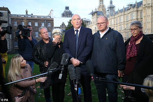 The family of Harry Dunn (left with blonde hair, his mother Charlotte Charles, and right his father Mr Dunn) have said a meeting with Foreign Secretary Dominic Raab over the death of their son felt like a 'publicity stunt' - as they confirmed they were launching civil action against the suspect in the case