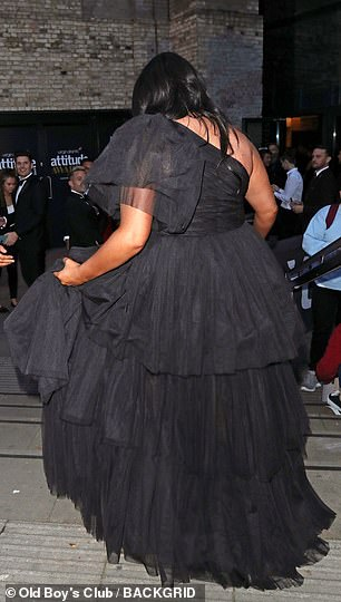 In tiers: The Beauty School Cop Outs star, 29, looked sensational in a billowing black gown with a high-rise hemline and billowing train as she glamed it up to the max